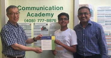 Atrey Desai receiving his gift certificate from Communication Academy's Director.